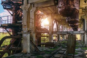 Abandoned ruined chemical plant with remain rusty tanks and pipes